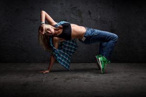 Girl dancing hip hop grunge concrete wall background